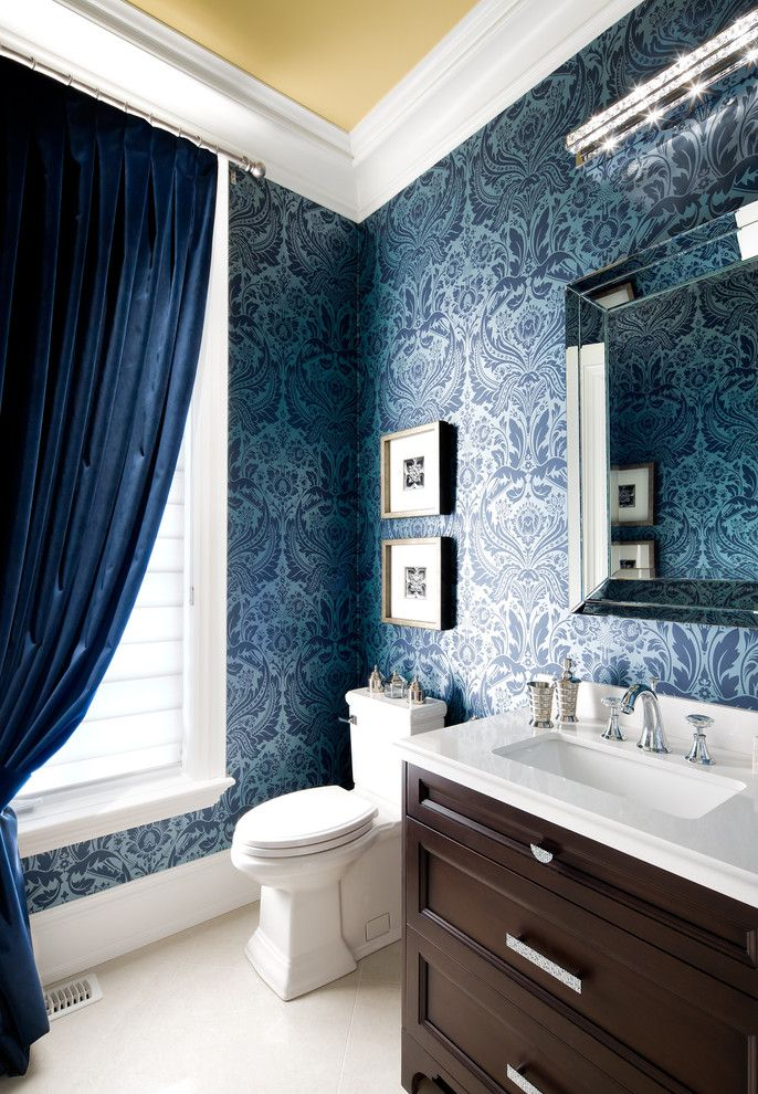 Colorful Wallpaper with blue velvet curtain blue velvet drapes blue wallpaper damask wallpaper dark wood vanity cabinet elongated toilet linear wall sco