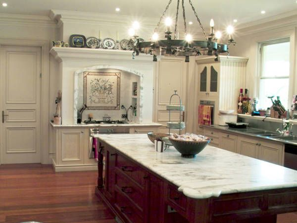 This French Provincial Kitchen Has The Classic Carrara Marble French Tiles And Rustic Wrought Iron Lighting To Complete The French Look