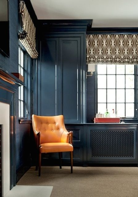 Hague blue semi gloss built-ins and millwork are perfectly matched by the custom dyed grasscloth in this den by Boston's own Annsley Interiors.