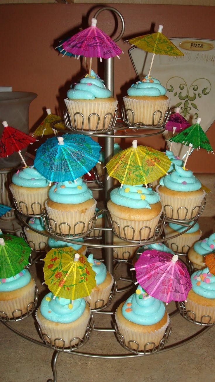 haiwaiian theme cake   Vanilla cupcakes with light blue butter cream frosting!