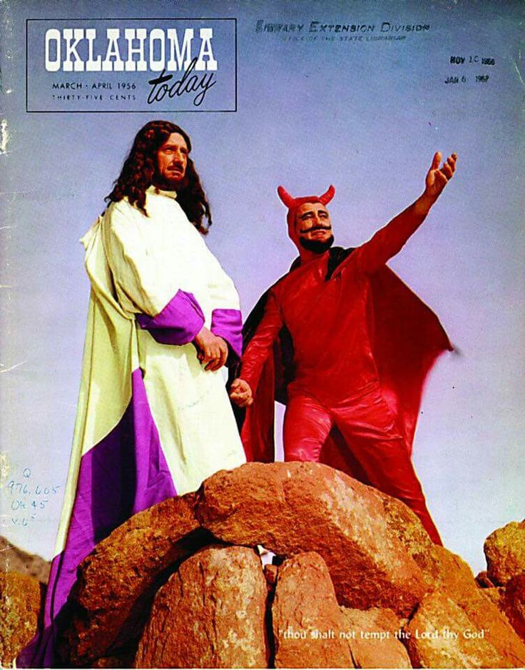 Jesus, a hippie Hitler in a choir robe, listens patiently to some guy in a cheesy Halloween devil costume.