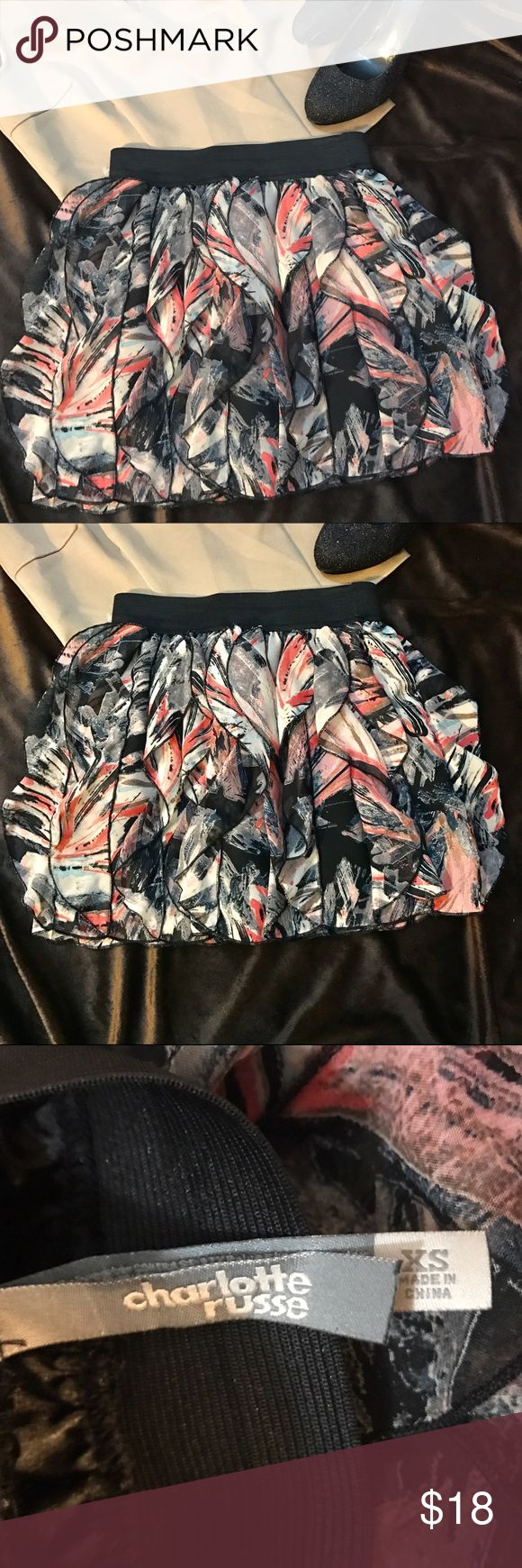 """🆕Flounced Abstract Skirt by Charlotte Russe An adorable Charlotte Russe chiffon flounce skirt in an abstract print of black, white, coral, beige and gray that can be worn for school, social, parties, or work. Black elasticized waistband, black lining and sheer layered chiffon made of 100% washable polyester. Waist measurement 11.5"""" unstretched, up to 15.5"""" stretched; hip 18"""" across the lining; length 12.5"""". Please note: shoes and/or accessories are for styling purpose and not included. Top…"""