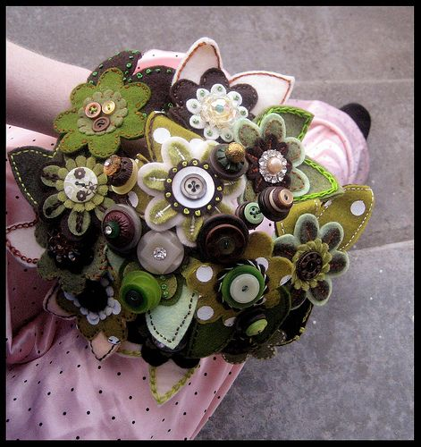 """Bouquet made by """"Princess Lasertron."""" Really. Despite the odd name, she does beautiful work. The wedding page where I found this has a few more felt ideas."""
