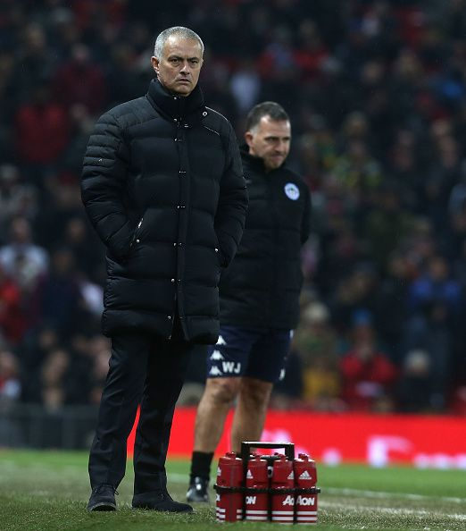 Manager Jose Mourinho of Manchester United and Manager Warren Joyce of Wigan Athletic watch from the touchline during the Emirates FA Cup Fourth...