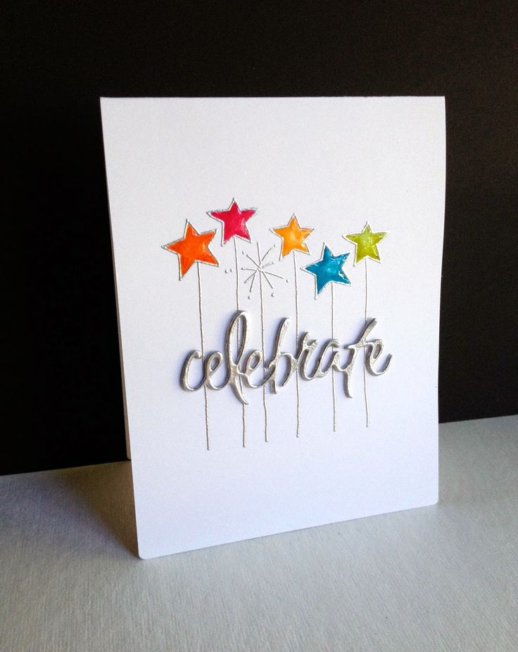 Silver embossed stars with bright colors stand out on a white base on this handmade birthday card. The die cut sentiment was made with layers and also embossed in silver.