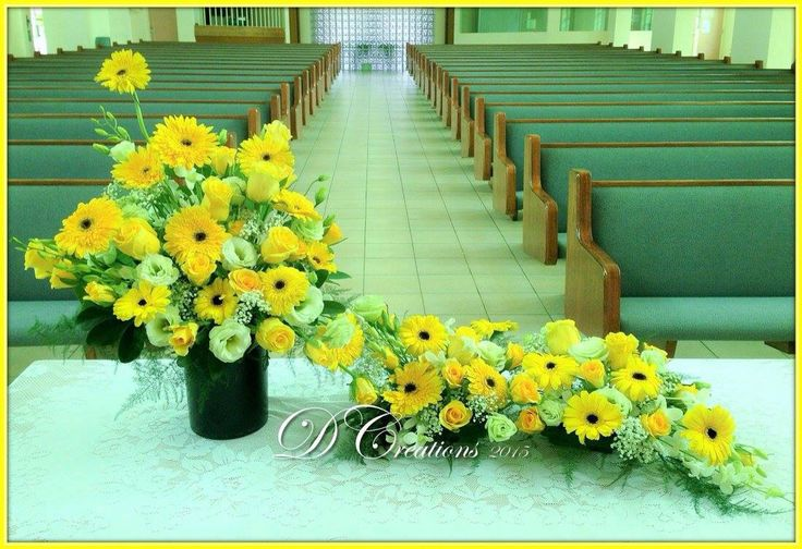 Yellow gerberas and white eustomas with a touch of baby's breath in a 3 piece arrangement