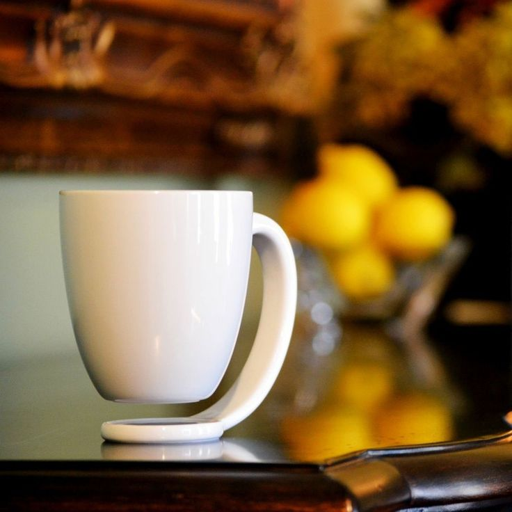 The Floating Mug, prevents burns on table from hot drinks and watermarks from cold drinks