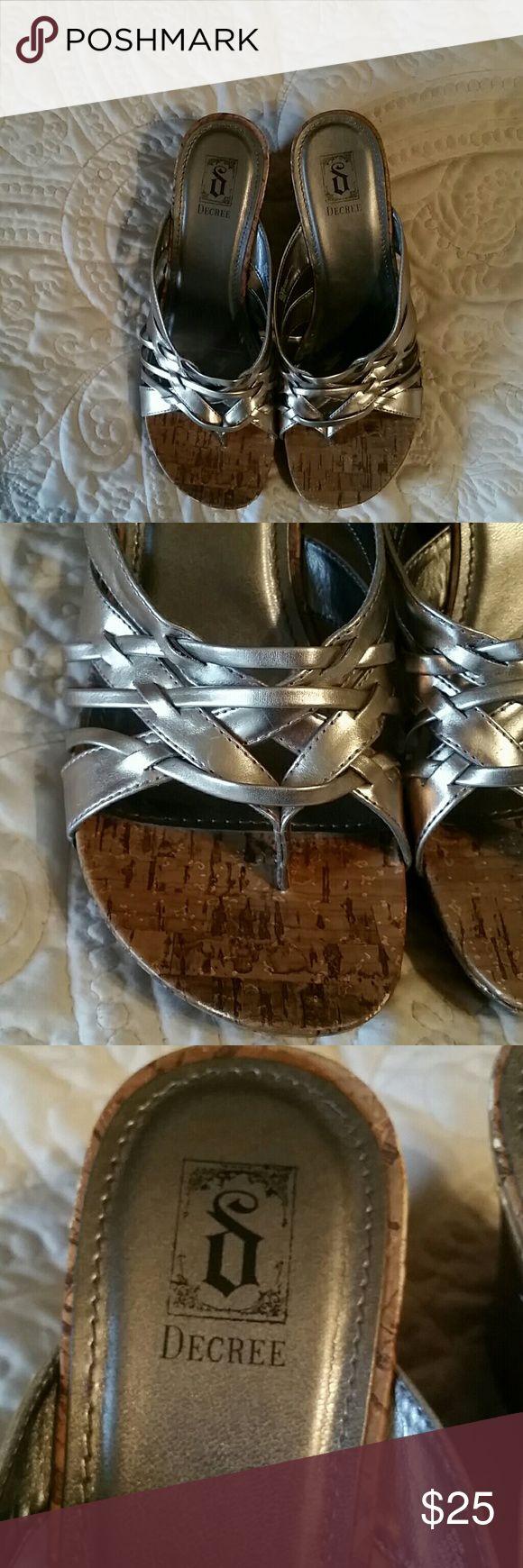 Metallic cork wedges NWOT Silver metallic with cork wedge. NWOT  beautiful sandal to dress up or down Decree Shoes Wedges