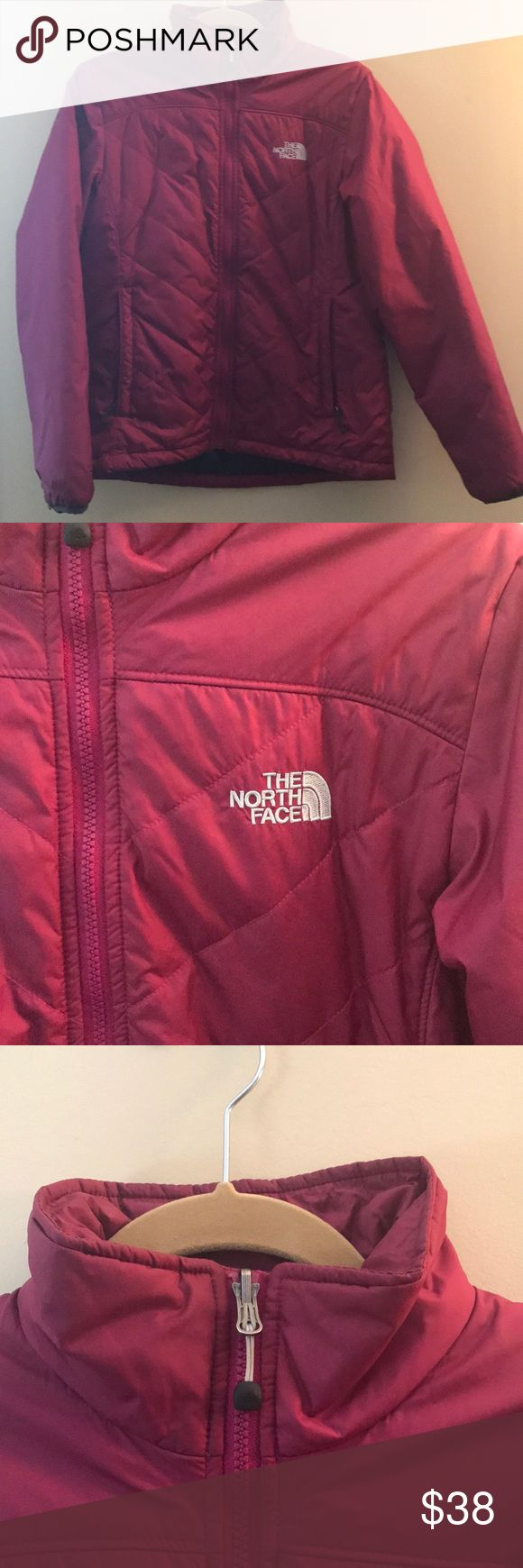 The North Face Pink Puffer Jacket Worn for one season has lots of life left to too big for me now. Purchased at the North Face outlet. Size medium. Right inside armpit has a rip that can easily be repaired. No noticeable rips or stains on the outside. Color is a deep pink. Very warm worn through a season in New Hampshire very comfortably! The North Face Jackets & Coats Puffers