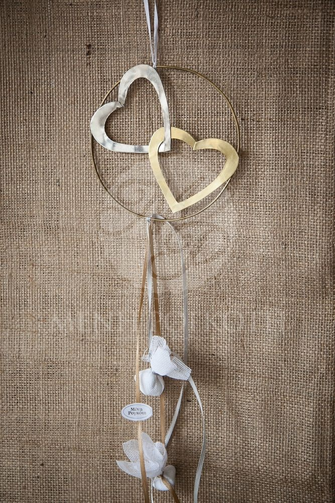 Handmade metalic wreath with one gold and one white heart wedding favor