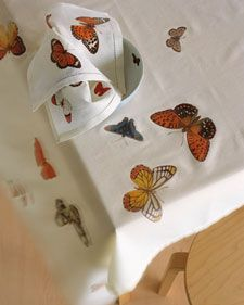 How to make these butterfly (or any clip-art image of your choice) table linens. All you need is the clip-art of your choice, transfer paper, linen table cloth and/or napkins and your iron.