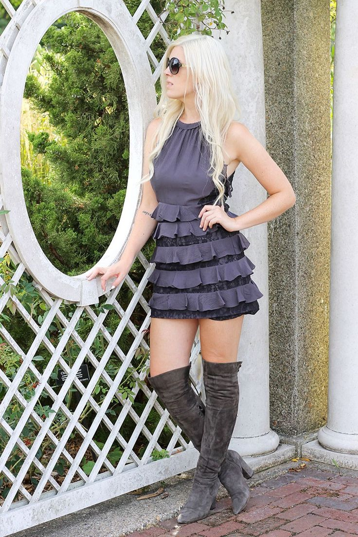 Emily Bache wearing dark grey over the knee boots