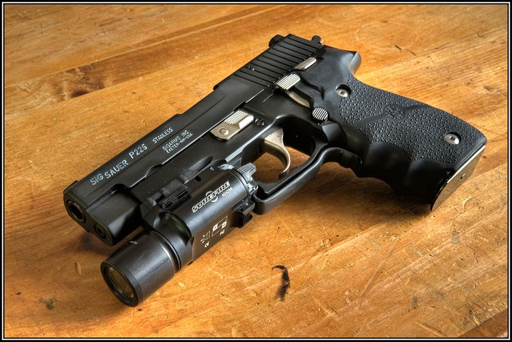 Nice.  Sig Sauer P226 Stainless with Surefire light and Hogue(?) grips.