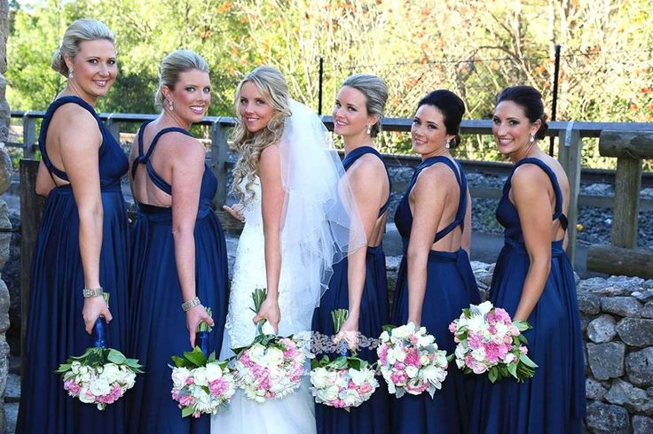 This back shot of our gorgeous Katie & her bridesmaids in their Goddess By Nature Signature Ballgowns in Nautical Navy colour.