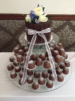 Delicious Chocolate Cake surrounded by Chocolate Cigars served with Sweetie Pies - Wedding Cake