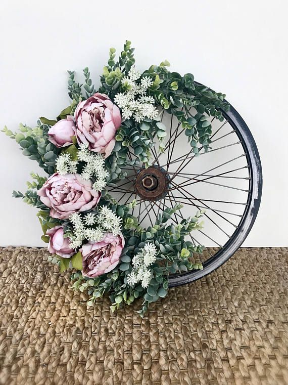 Another Vintage Bicycle Beauty! Topped with Succulent garland and mauvey-pink peonies and white queen anne's lace. Wreath size will vary depending on what vintage bike wheels are in stock. Wheels are acquired while antiquing and scouring vintage markets, therefore, making them truly