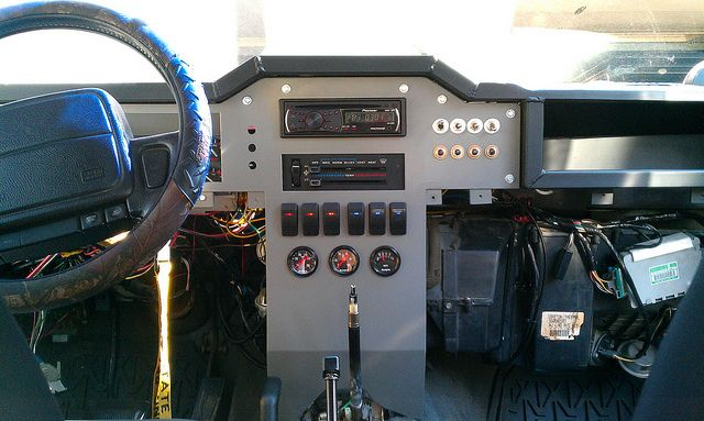 Really nice write up on custom XJ Dash  http://www.jeepforum.com/forum/f11/write-up-custom-dashboard-fabrication-wire-harness-mod-1393978/index3.html