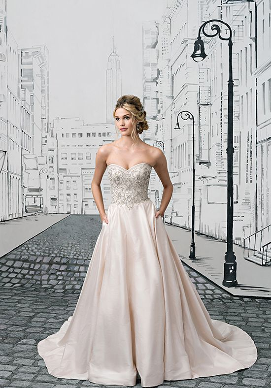 You will shine in this fully beaded bodice, Silk Dupion skirt with pockets, and Silk and rhinestone buttons to the end of the cathedral length train. Add our detachable beaded straps for another pop of glamour. Gown style also available in Regal Satin as style 8883A.
