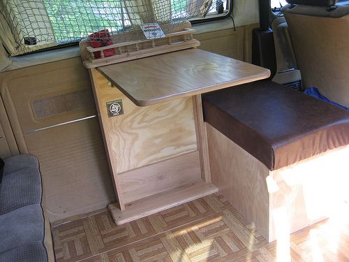 Custom foldable table with extra storage seat. Van camper conversion.
