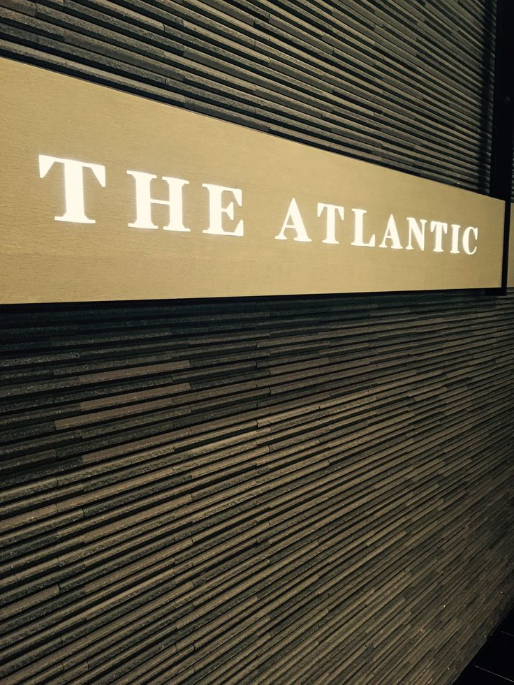 Project 10, Atrium & riverwalk: rough slim tiles are a very modern and textural finish to the entry to the Atlantic restaurant
