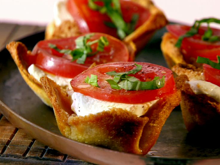 Get this all-star, easy-to-follow Food Network Caprese Tartlets recipe from Melissa  d'Arabian.