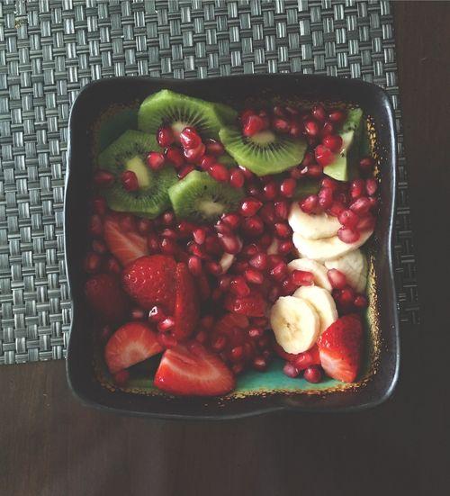 Kiwi, strawberry, banana, and pomegranate