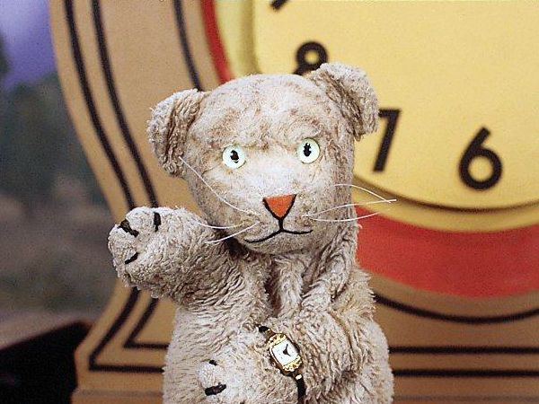 Why yes this is Daniel Striped Tiger  He lives in a clock. . .he's awesome  (and there are some days where I want to run off to the Neighborhood of Make-Believe and live with him)