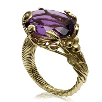 Purpura Ring by Sophie Harley. Beautiful cocktail ring in 18ct ethically mined gold with an oval faceted amethyst set with intricate unraveled vines & leaves.