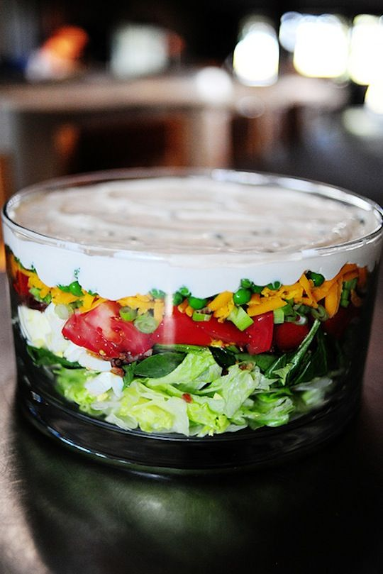 "Seven-Layer Salad. My mom has a fantastic all-green seven-layer salad she used to make for barbecues, served out of this amazing now-vintage bowl (that I've seen selling from ""retro boogie"" shops [as my uncle is wont to call them] for fifty bucks). I've made it a few times for outdoor parties I've been invited to. Time to resurrect the layer salad for summer. Source: Dana Velden for The Kitchn"