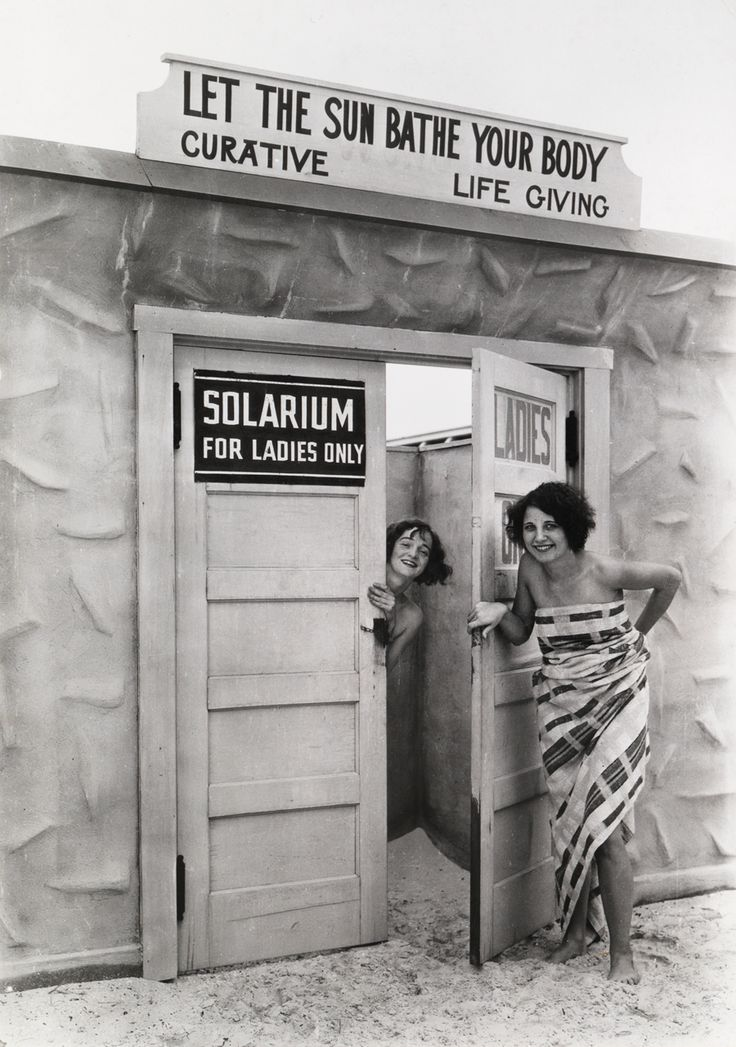 "Bathing beauties emerge from a solarium"" (a tanning booth), in St. Petersburg, Florida, June 1929.Photograph by Clifton R. Adams, National Geographic"