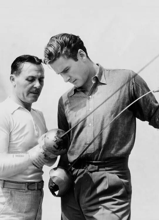 Errol Flynn with a fencing instructor