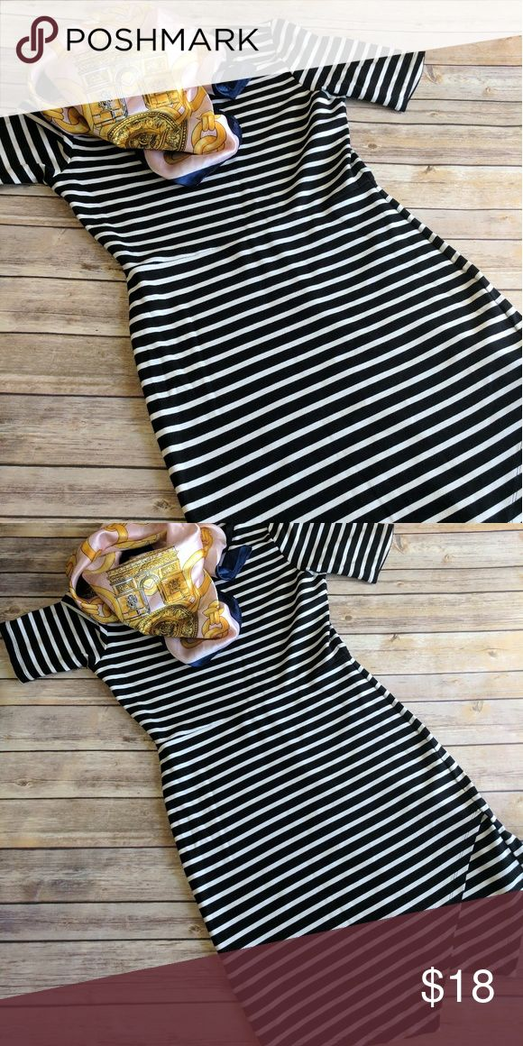 Black+White Striped Lumiere Dress La petite Lumiere brand dress with asymmetrical hemline. Made of a stretch cotton that is thick enough to accentuate curves rather than unflatter (I'm looking at you, jersey knit). A great addition to that developing capsule wardrobe! Lumiere Dresses Mini