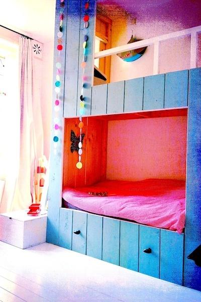 Cosy bed nook with mezzanine play area. Bright, cheery kids bedroom.