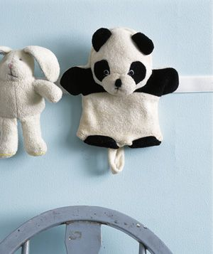 "Trick 9: Take Advantage of the Walls  Instead of cramming stuffed animals into a bottomless bin, create a warm-and-fuzzy wall display. Sew a piece of woolly Velcro to the back or side of each toy,then apply strips of adhesive Velcro to the wall (low, within toddlers' reach). It's easier to get kids to pick up when they can rearrange their friends and tell a story at the same time. ""And then Pig chased Strawberry Shortcake…"""