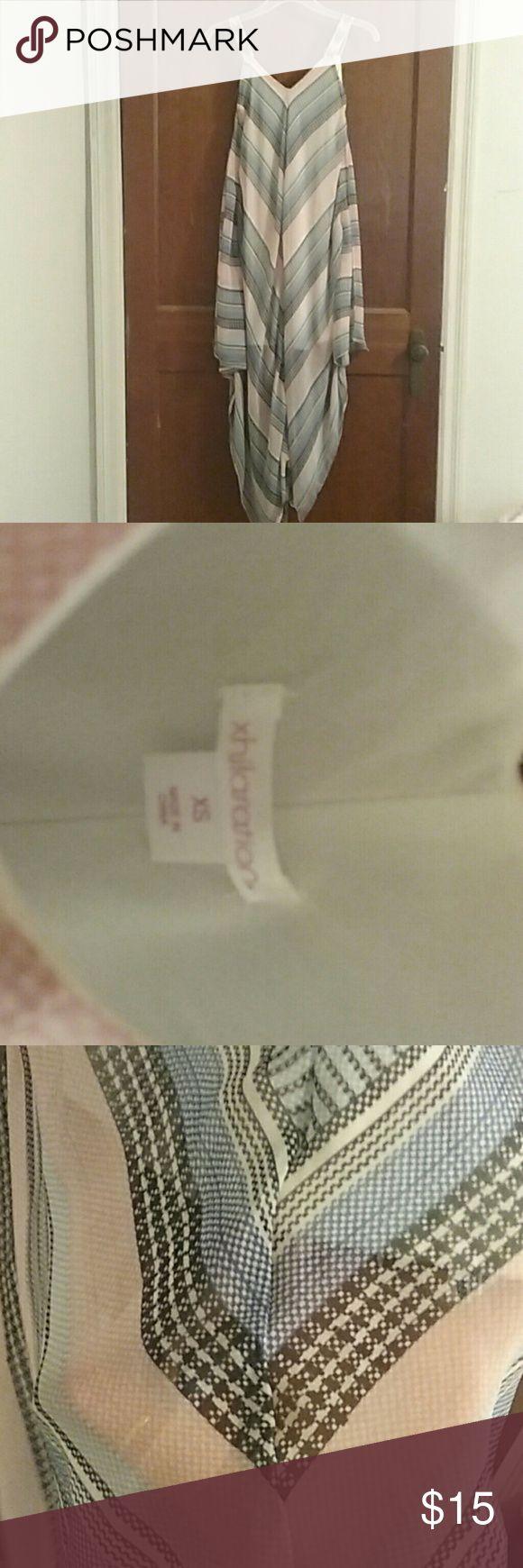 Lined handkerchief chevron print dress Falls slightly below the knee, soft pink, soft blue, black, white and dark blue alternating chevron pattern. Worn once, no frying, rips, or tears. Xhilaration Dresses Asymmetrical