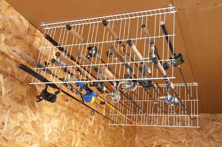 Fishing Rods - wire racks hung from the ceiling or can mt. them to the wall, snip out or bow out wire steams for the rod handle.