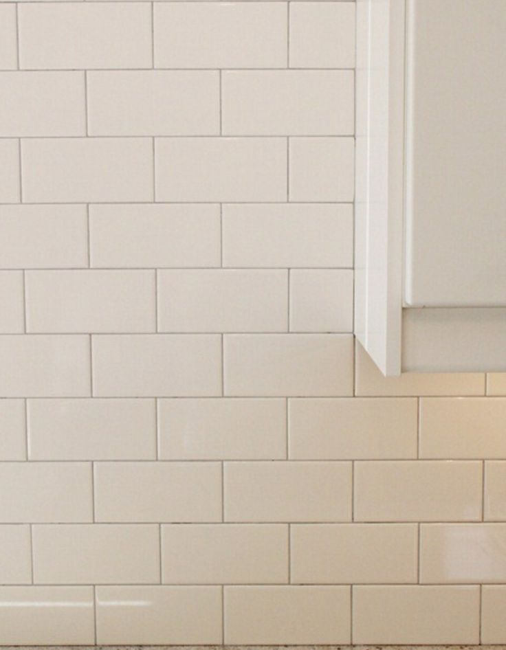 White Subway Tile With Tight Light Gray Grout Lines