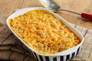14 oz. Macaroni & Cheese 1 c. shredded cheese, divided 1/2 c. sour cream 1/4 tsp. ground red pepper 6 Ritz crackers, crushed (about 1/4 cup) 1 Tbsp. margarine, melted HEAT oven to 375°F. PREPARE Dinner as directed on package. Stir in 1/2 cup shredded cheese, sour cream and pepper; spoon into sprayed casserole. Top with remaining shredded cheese. MIX cracker crumbs and butter; sprinkle over ingredients in casserole. BAKE 20 min. or until heated through.