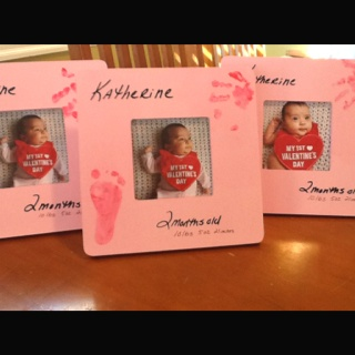 Baby's valentine picture. Inexpensive wood frame, painted. Foot and hand prints made with nontoxic, washable paint (and baby of course!)