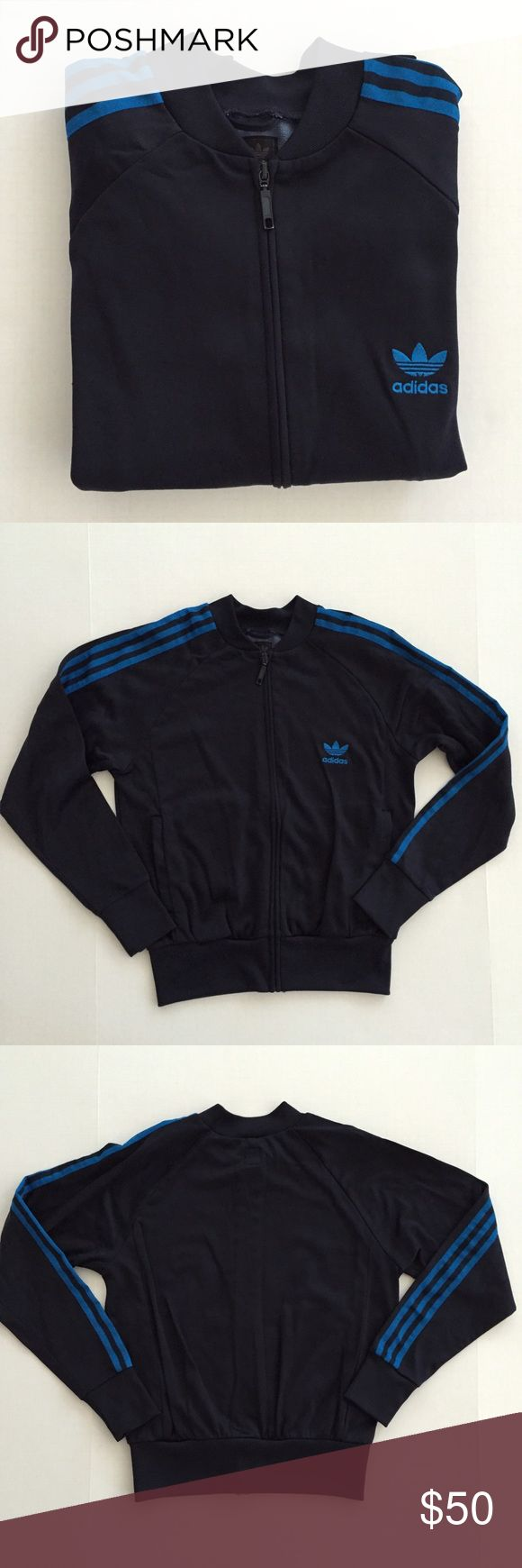 [Adidas•Originals] women's track zip-up jacket S-M [Adidas•Originals] women's track zip-up jacket S-M •🆕listing •great pre-owned condition •navy blue with brighter blue stripe detail and embroidered logo •size runs like S-M, tag size L •full zip front, 2 pockets •material 78% nylon 22% polyester, exterior swishy, interior soft fleece-like feel •zipper paint has some chipping when looking very closely, otherwise great condition •offers welcomed using the offer feature or bundle for the best…