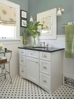 love this cute little bathroom. like the green with they grey green.