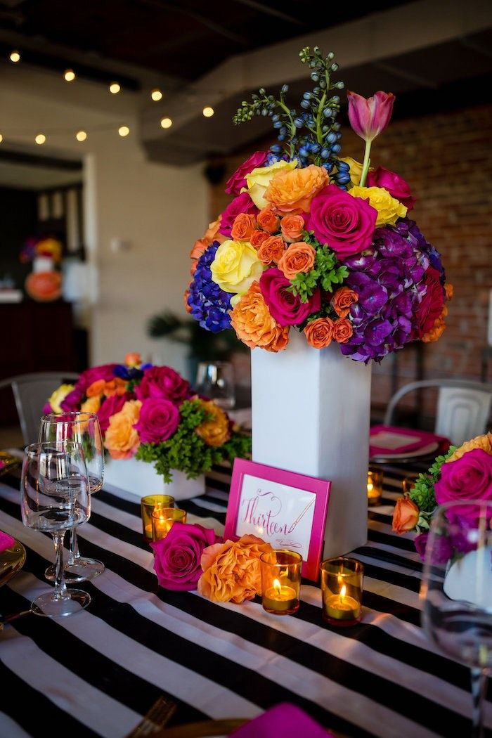 Gorgeous floral-adorned guest table from Floral + Art Tween Birthday Party | Bat Mitzvah at Kara's Party Ideas. See plenty of pictures at karaspartyideas.com!