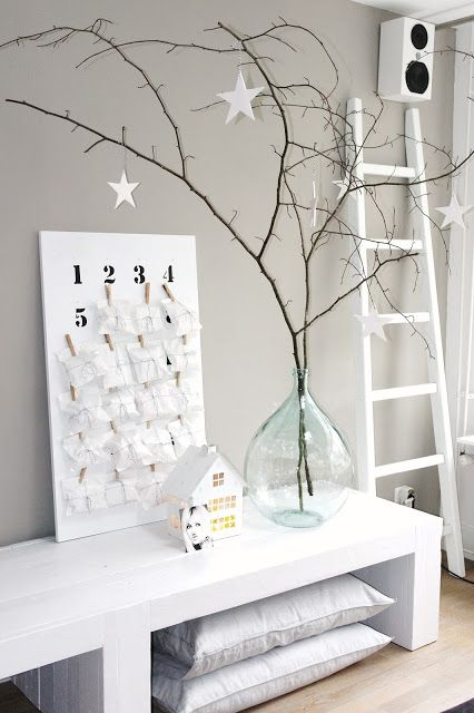 Contemporary Christmas styling with minimalist Christmas tree and homemade advent calendar.