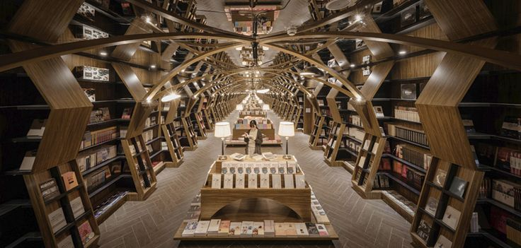 Zhongsuhge-Hangzhou bookstore features glass walls and circular bookshelf pillars, offering an amazing collection of books.