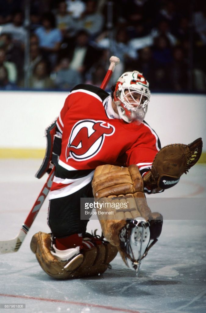 goalie-glenn-chico-resch-of-the-new-jersey-devils-makes-the-glove-picture-id667961806 (675×1024)