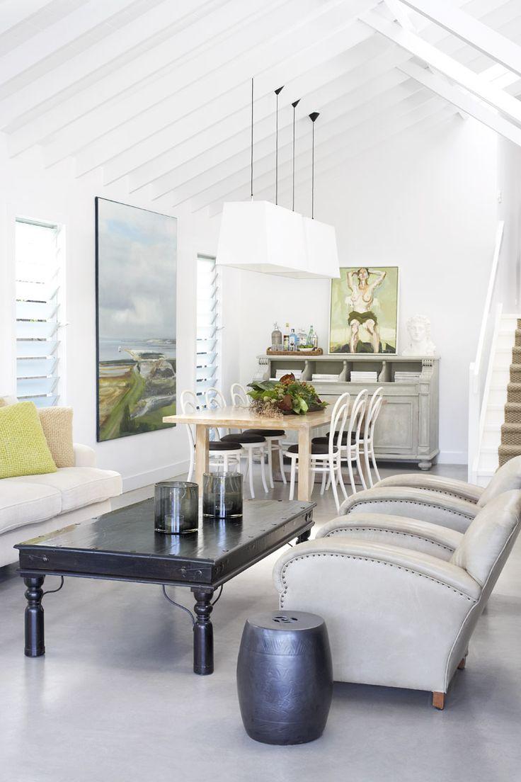 This is What Lady-Like Minimalism Looks Like//concrete floors, black coffee table, garden stool