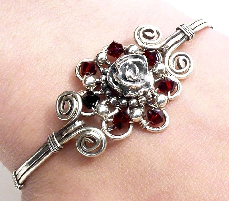 Silver and red rose bracelet, flower bangle, gothic bangle, dark red sterling silver bangle, wire wrapped jewelry handmade bracelet. $155.00, via Etsy.