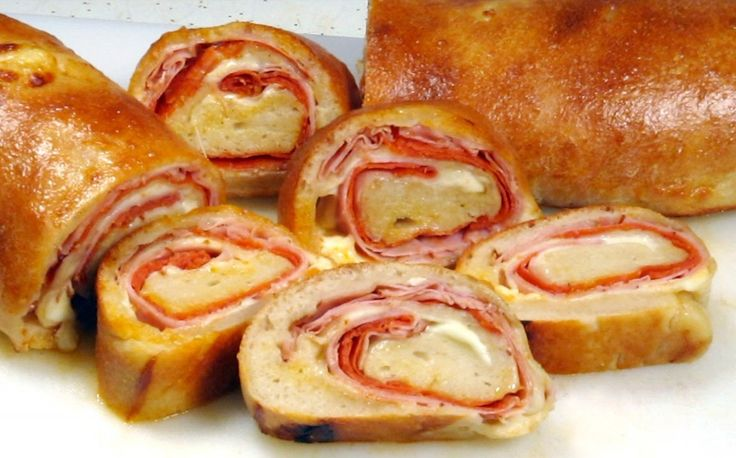 This is nice way to make a hot sandwich on a cold afternoon. The flavors come together and soak into the dough. I like to serve this with my favorite soup while watching the big game. This is also good finger food to bring to a party. Your friends will love the presentation.