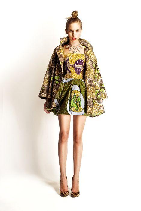 Stella Jean. freakin' all of it: batik print, voluminous dress, loud coat, leopard heels, boisterous costume jewelry... I am ALL over this.