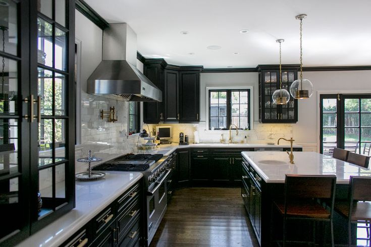 Amazing Kitchen Black Cabinets Glass Cabinets White Marble Countertops Vintage Light